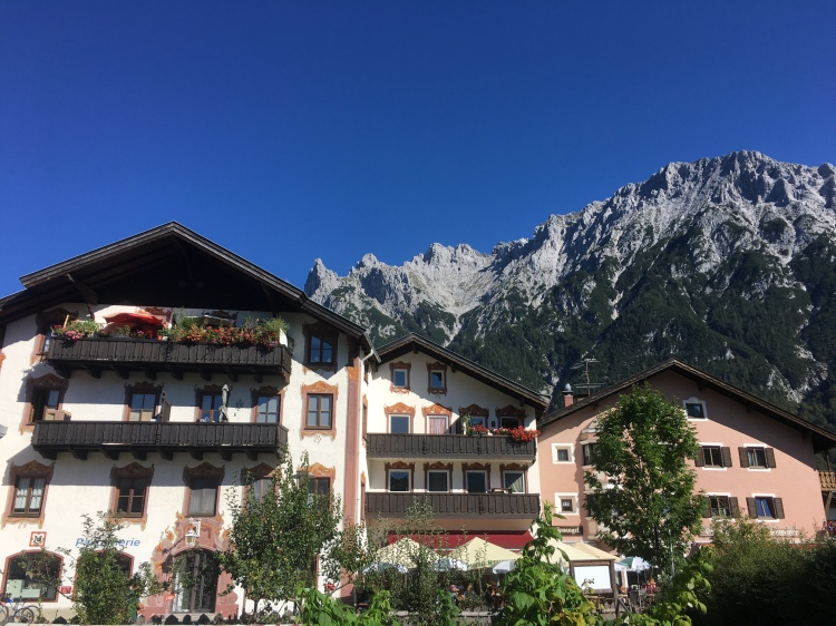 Mittenwald buildings with mountains in the background.