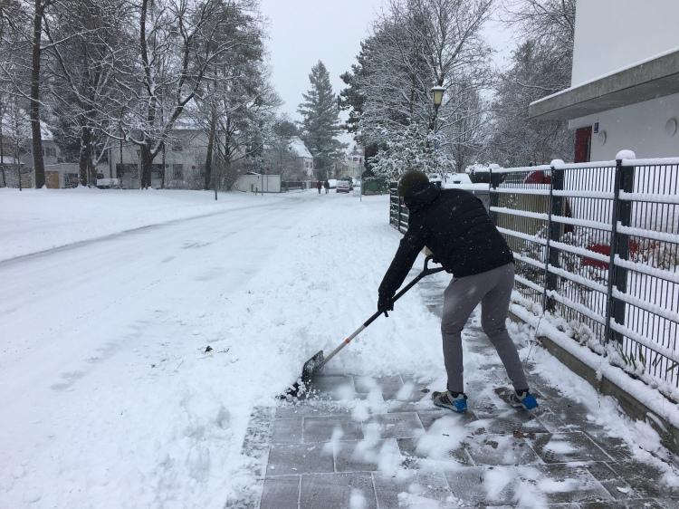 Shane shoveling snow.